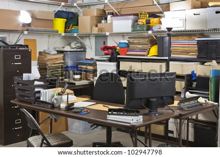 Busy warehouse office shipping and receiving department desk. - stock photo