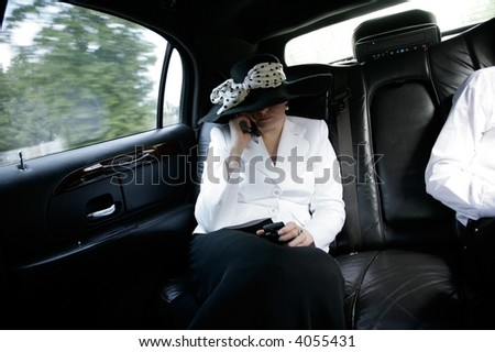 busy woman in luxurious car