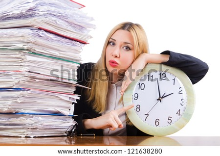 Busy woman with clock on white - stock photo