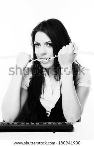 Busy woman working and tied up on the line  - stock photo