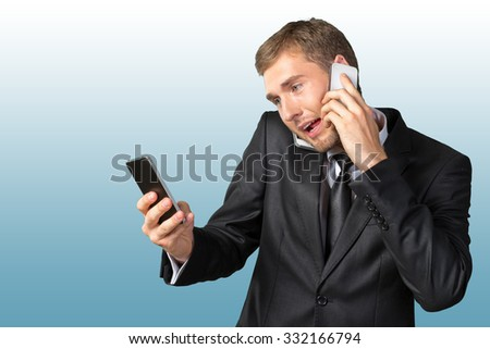 Busy young businessman talking the phone