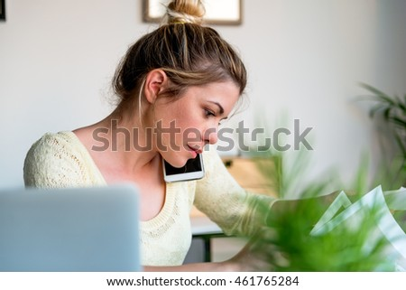 Busy young woman