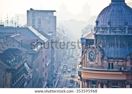 Busy Zagreb street in morning haze with old architecture aerial view, capital of Croatia - stock photo