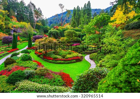 Butchart Gardens -  gardens on Vancouver Island. Flower beds of colorful flowers and walking paths for tourists. The world-famous masterpiece of park architecture - stock photo