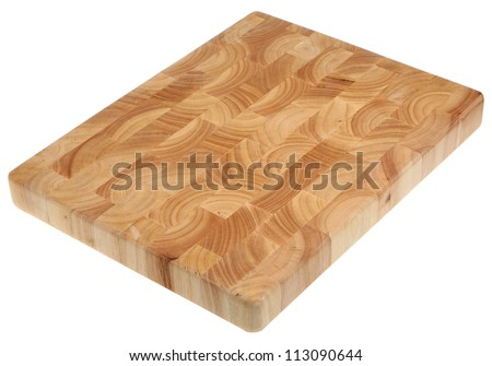 Butcher's block wood chopping board, new and without scratch marks. - stock photo