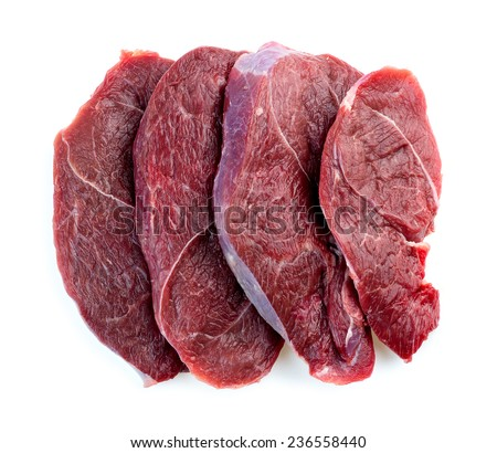 Butcher shot of beef steaks isolated in studio - stock photo