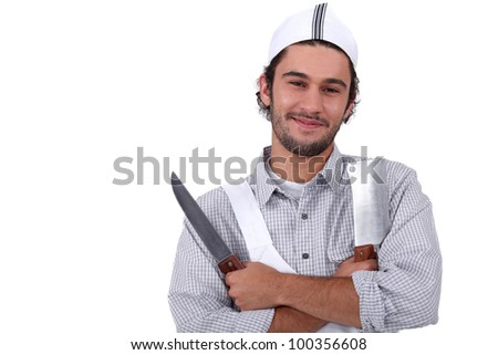 Butcher with two knives - stock photo