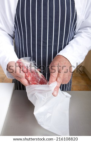 Butcher wrapping meat