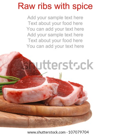 butchery : fresh raw beef lamb big rib ready to cooking with green stuff on wooden plate isolated over white background - stock photo
