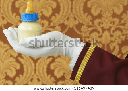 Butler's Hand with Bottle of Milk