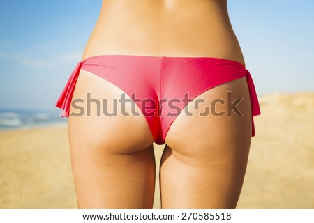 Butt view of a sexy woman in bikini - stock photo