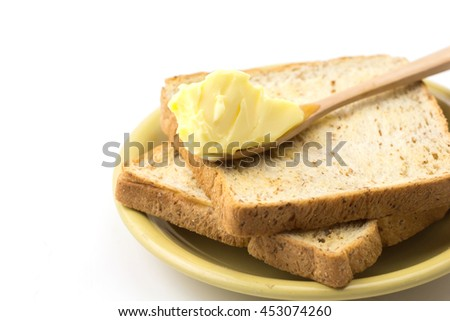 Butter and breads on white background