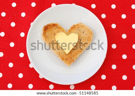 Butter and toast in a heart shape - stock photo