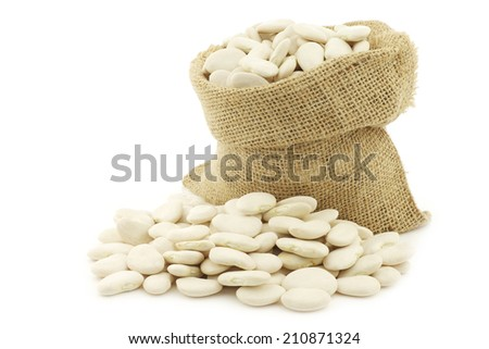 Butter beans (lima beans) in a burlap bag on a white background - stock photo