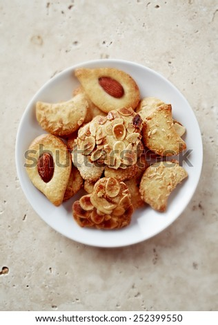 Butter cookies with almonds on a plate   - stock photo