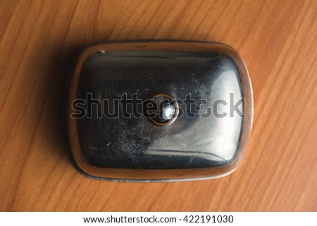 Butter dish close up. For butter. On a wood background. - stock photo