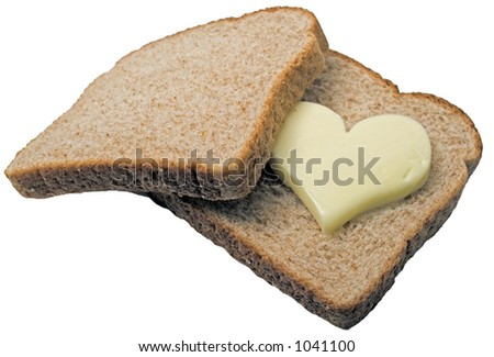 Butter heart melts in between two slices of bread.