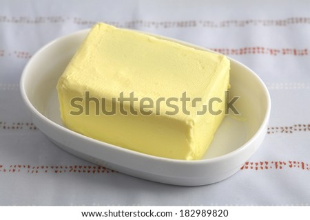butter in a cup in natural light - stock photo