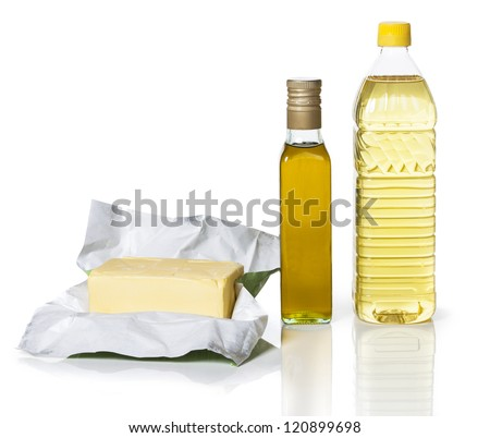 Butter in paper and two bottles of different types of oil on white background - stock photo