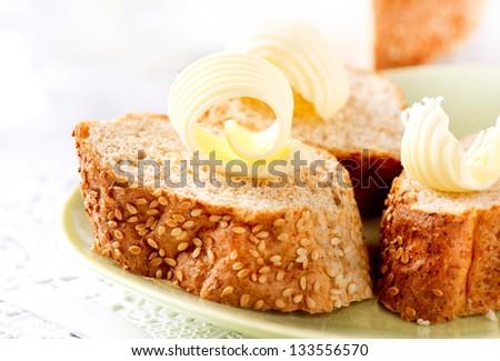 Butter on a Slice of Bread. Butter Rolls. Healthy Breakfast - stock photo