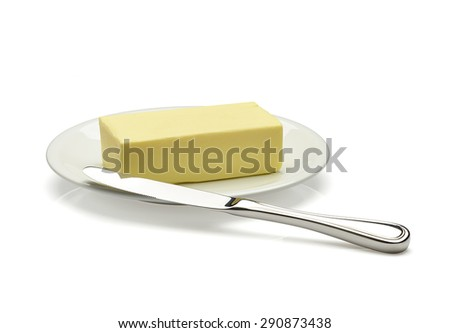 butter on plate with knife - stock photo