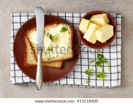Butter spread on sliced healthy grain bread, top view