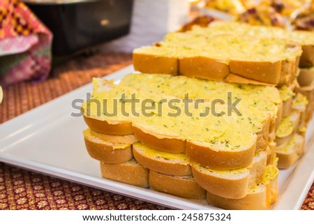 Buttered bread on the tray