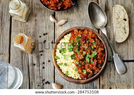 buttered millet with tomato eggplant curry. the toning. selective focus - stock photo