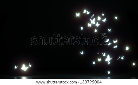 butterflies fluttering in the air, on a black background - stock photo
