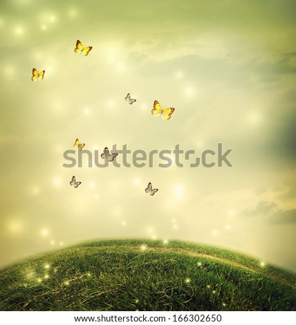 Butterflies in the shinning fantasy hilltop landscape  - stock photo