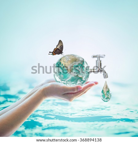 Butterfly drinking water from green globe tap on woman human hand on blur natural blue ocean background World environment concept: Saving water conceptual csr idea: Element of image furnished by NASA - stock photo