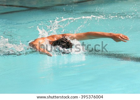 Butterfly stroke  in the swimming pool