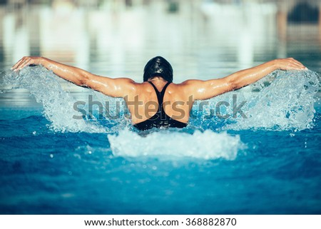 Butterfly style swimming - stock photo