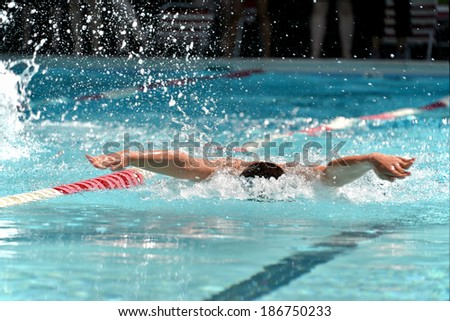 Butterfly swimmer during a swim meet