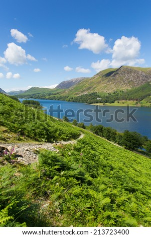 Buttermere English Lake District Cumbria England uk on a beautiful sunny summer day surrounded by fells   - stock photo
