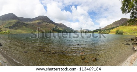 Buttermere lake in Lake District in England looking down length of the water - stock photo