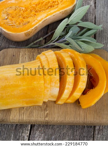 butternut squash over old wood background - stock photo