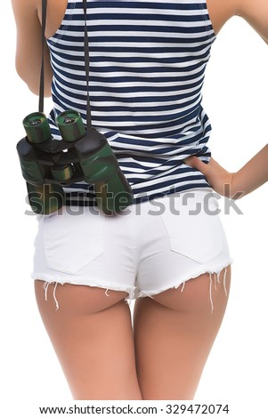 Buttocks of girl close-up. Girl spy. Young girl with a beautiful buttocks. Girl sailor. - stock photo