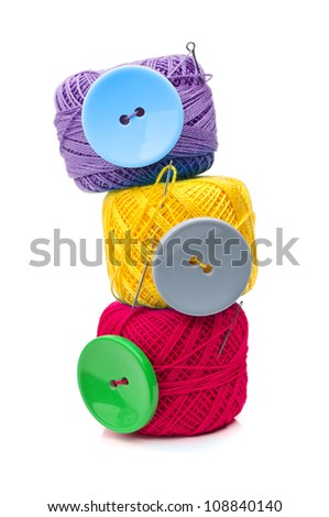 button and ball yarn isolated on white background - stock photo