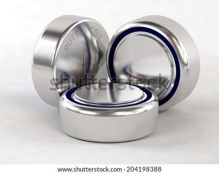 Button cell batteries on white background - stock photo