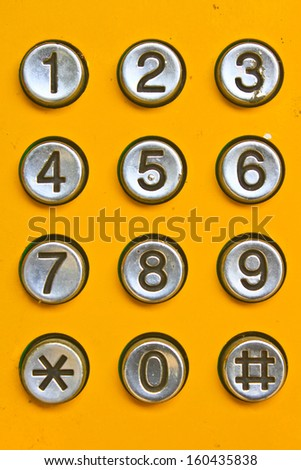 button number public telephone coin in Thailand - stock photo