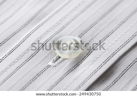 button of business shirt, close-up - stock photo
