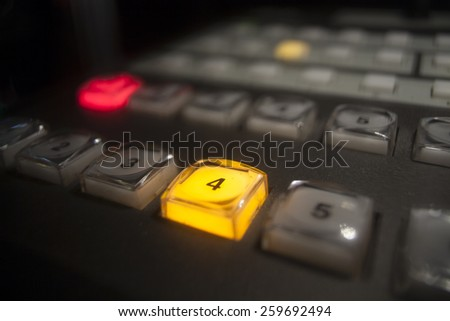 button on the control panel television equipment  - stock photo