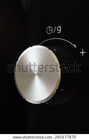 Button Timer control on microwave - stock photo