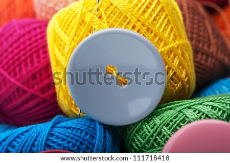 button with yarn thread background - stock photo
