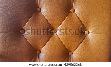 Buttoned on the orange Texture. Repeat pattern - stock photo