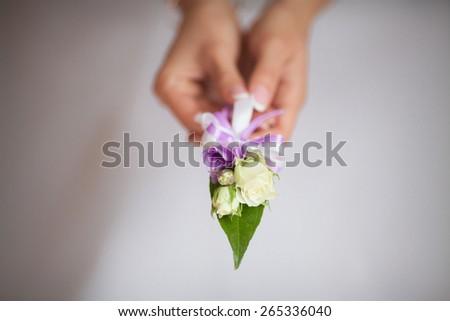 buttonhole flowers wedding - stock photo