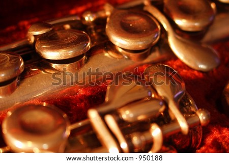 Buttons and keys on a well-worn brass horn