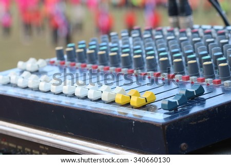 buttons equipment for sound mixer control, focus yellow botton