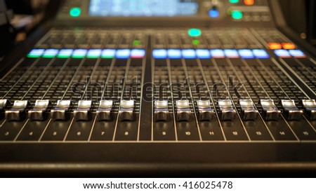 buttons equipment for sound mixer control with blurry background and selective focus - stock photo